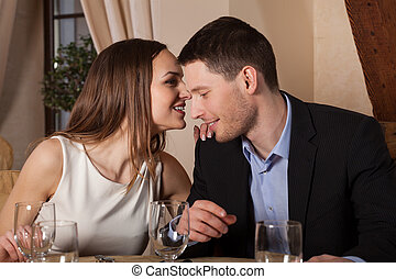 Woman whispering to her man