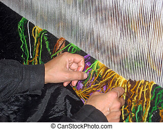 woman who works  the colorful wool and she produce carpets 2