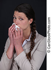 Woman wiping mouth with tissue