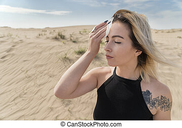 Woman wiping sweat from her forehead