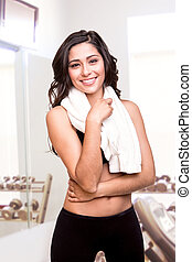 Woman wiping sweat with towel