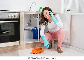 Woman Wiping While Talking On Mobile Phone - Happy Woman...