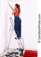 Woman wiring a room