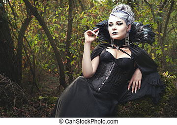 Woman witch in corset. - Beautiful young woman a witch, she...