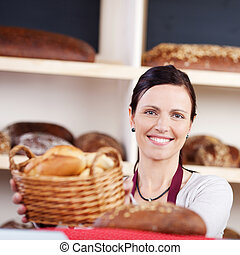 Woman with a basket of fresh rolls