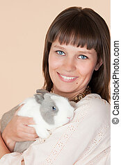 woman with a beautiful rabbit
