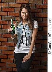 Woman with a beer - twenty something girl leaning against...