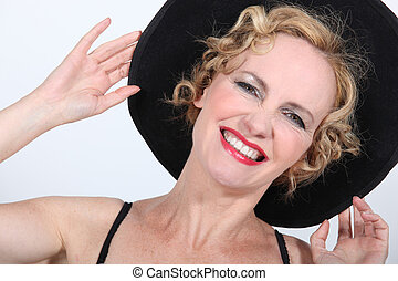 Woman with a big black hat