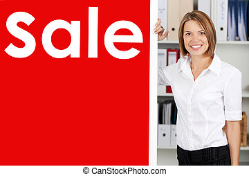 Woman with a big red Sale sign