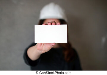 woman with a blank sheet of paper in his hand on...