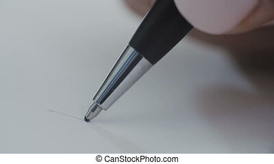 Woman with a blue ball pen writing letters