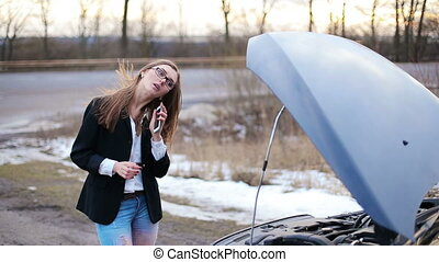 Woman with a broken car calling for help
