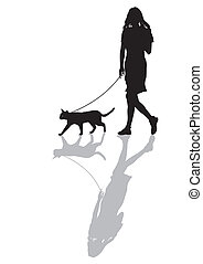 Woman with a cat on a leash