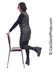 woman with a chair in white background