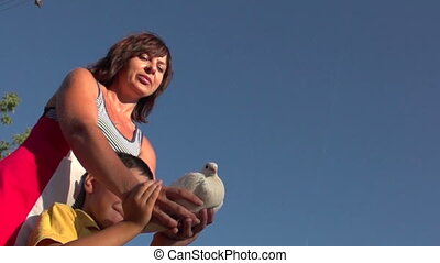 woman with a child produces dove