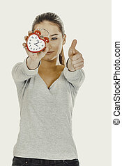 Woman with a clock and thumbs up.
