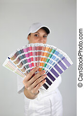 Woman with a color swatch