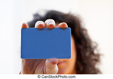 Woman with a credit card on her hand