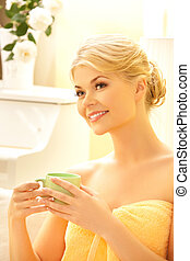woman with a cup - attractive woman in spa salon with a cup