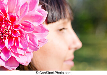 Woman with a dahlia in her hair
