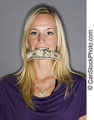 Woman with a dollar-bill in her mouth