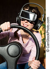 woman with a driving simulator and virtual reality glasses