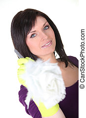 Woman with a feather duster