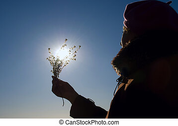 woman with a flower in the sun