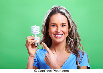 Woman with a fluorescent bulb