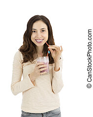 Woman with a glass of smoothie