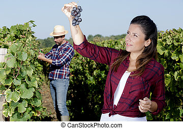 woman with a grape brush on her shoulder