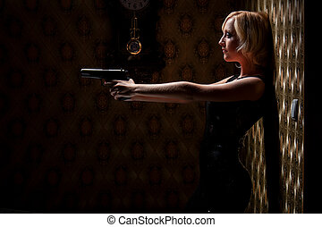 Woman with a gun in the room.