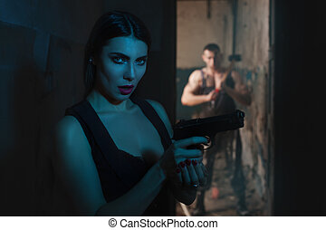 Woman with a gun.