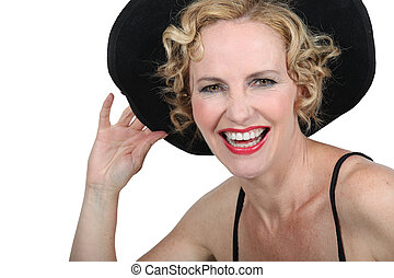 woman with a hat laughing