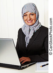 woman with a headscarf in the office