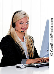 Woman with a headset and computer Hotline at