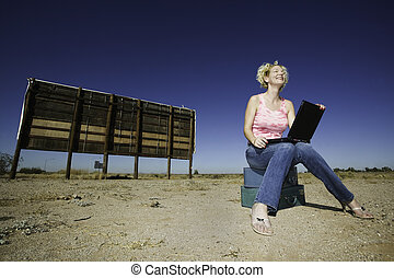 Woman with a laptop ourdoors