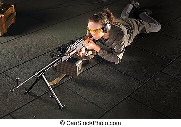 woman with a machine gun