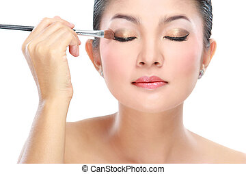 woman with a make up brush