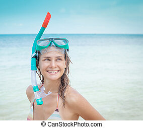 woman with a mask for snorkeling in the sea background