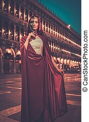 Woman with a mask on San Marco square in Venice