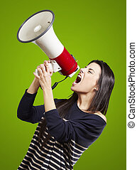 woman with a megaphone - young woman shouting with a...