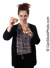 woman with a muffin on white background
