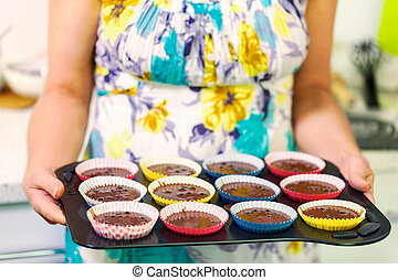 Woman with a muffins tray