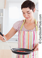 Woman with a pan