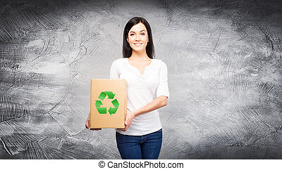 Woman with a paper bag with an ecology symbol