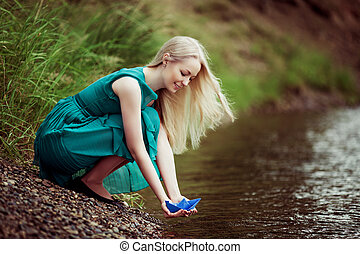 woman with a paper boat