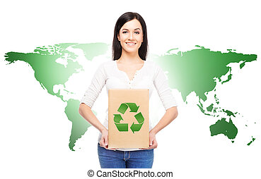 Woman with a paper box and recycle sign on it. Ecology, environment, and a world saving concept. World map background.
