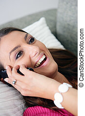 Woman with a phone in bed