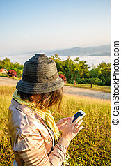 Woman with a phone in her hand